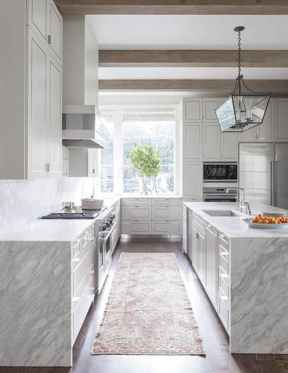 grey-and-white-quartzite-waterfall-edge-countertop-red-and-gold-rug